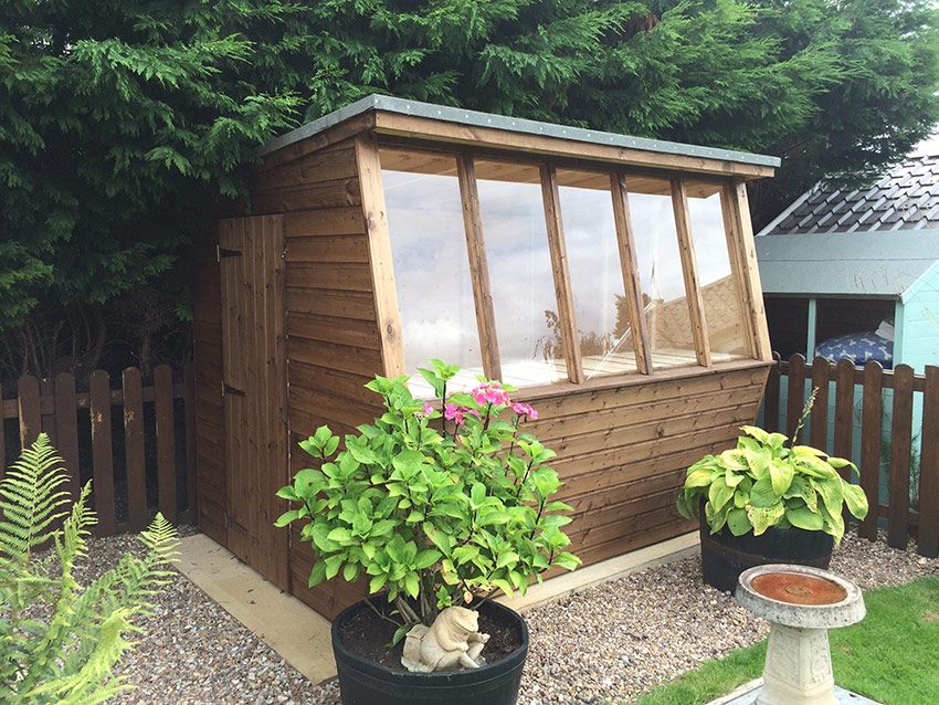 Wooden garden potting sheds